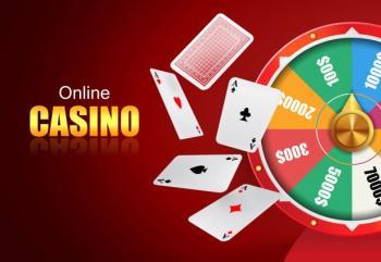 """Texten """"Online casino"""" samt en kortlek och ett lyckohjul."""